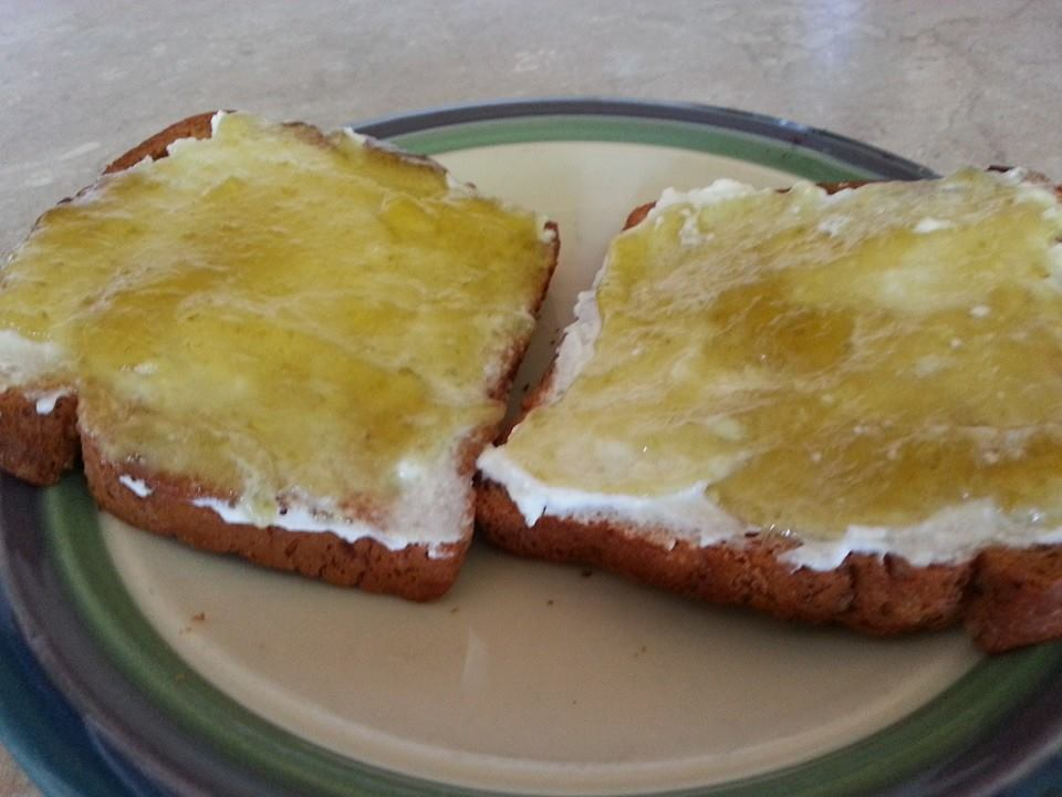 Goat milk cream cheese on toast with jalapeno jelly.